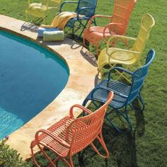 #49100 Rizza Chair 299.00  2 in coral/tangerine would be perfect  use coupon code in Favorites