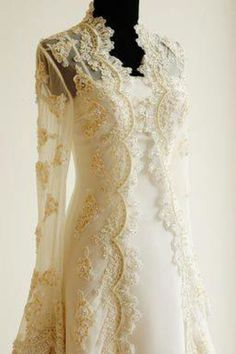 Irish wedding dress.. I love the idea of the gold lace on top of a dress!