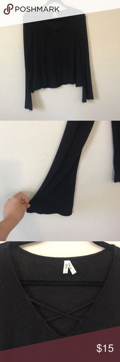 Cropped black bell sleeve top Black cropped top with bell sleeves and a crossed front detail. Perfect for nights out, causal days, festival looks, gothic, romantic, perfect for holidays! Super soft and stretchy material and fit up to size medium! Tops Crop Tops