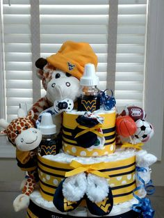 Check out this item in my Etsy shop https://www.etsy.com/listing/266399750/sport-themed-diaper-cake-3-tier-custom