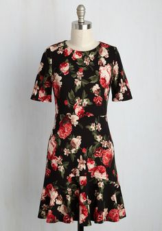 Flirty South Floral Dress. Whether dancing through NOLA, skipping through Atlanta, or twirling through Nashville, the red, ivory, and green florals on this black dress will invite others to bop along. #black #modcloth