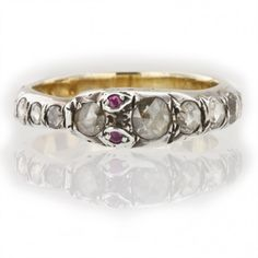 A Georgian diamond-set snake ring, the ring set with eighteen graduated rose-cut diamonds, estimated to weigh a total of 2.2 carats, with ruby eyes, all cutdown collet-set in silver to a yellow gold mount, gross weight 3.1 grams, circa 1790
