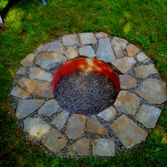 Outdoor fire pit. Neat idea to sink the fire ring into the ground.