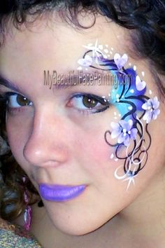 Blue eye swirl face paint.  Homemade Tag split for background (similar to a dolphin split), DFX white and Black.
