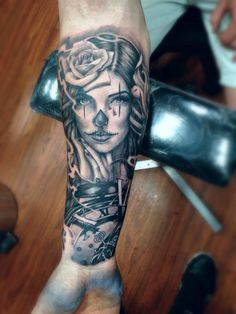 Man forearm, mexican tattoo with woman, rose and time symbols