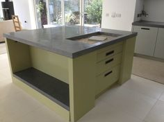 mixed cupboard colours and dark concrete top