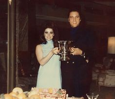"""May 1968 Elvis and Priscilla had their first wedding anniversary. It was catered by the Deli Restaurant at the house. Priscilla received flowers from Elvis with a card saying: """"Love, Elvis. Elvis Presley Priscilla, Elvis Presley Family, Elvis Presley Photos, Mein Hobby, Family Photo Album, First Wedding Anniversary, Great Love Stories, Famous Couples, Lisa Marie"""