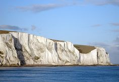 White Cliffs of Dover, England. Majestic and inimitable, I'd probably need to see these from a boat offshore, since standing on the edge of the cliff would probably cause me to lay spreadeagled on the ground to avoid getting too close to the edge.