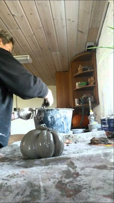 Pumpkin Could be made with hypertufa? I can't understand her but I think I get the idea. She used a nylon.