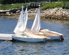 Summer time.  3 sail boats in the water at Chester, Nova Scotia, Canada.  Coastal fun.  Photo by J. Underwood.