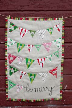 A holiday treat can be inside each triangular pocket on this mini quilt advent calendar.