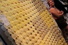 yellow and beige yo-yo quilt