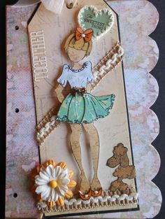 "Lani's Prima Paper Doll is ""Sweeeeeeeet""! So many wonderful Prima embellies, too. And Lani's signature .... always a puppy dog on her tag! Prima Paperdoll Club at Simple Pleasures."