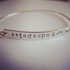 Raindrops and rainbows bangle on Etsy, £11.95
