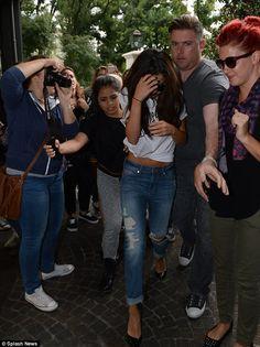 Coming through: The mega superstar princess Selena Gomez was escorted through the crowd