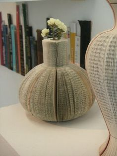 Laura Cahill, a graduate designer who has a zeal for sustainable design, presented vases and furniture made from unwanted books at New Designers in London earlier this year. Laura doesn't like seeing old books getting thrown away, and has developed delicate yet practical designs using low energy methods
