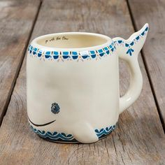 Folk Art Mug - Whale This folk art mug will have anyone smiling every time they drink from it! With an adorable whale design, they'll be reminded to 'go with th