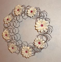 bed spring wreath, but with different embellishments... for the old bed in the yard