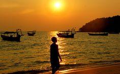 A Khmer boy walks along the beach as the golden sunset radiates the surroundings - Sihanoukville, Cambodia. This is a travel photo from Sihanoukville, Cambodia. Boy Silhouette, Cambodia Beaches, Cambodia Travel, Travel Images, Travel Photos, Travel Tips, Battambang, Phnom Penh, Sun