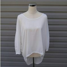 White Hi-Lo Top White 3/4 Sleeve Hi-Lo Top   This is NWOT Retail. Price Firm Unless Bundled Tops