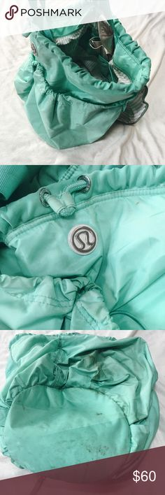 Lululemon sports bag Used lululemon bag. Very obvious discoloration on bottom of bag. Several years old and has been used ❤️ but the bag itself is in good shape and will last for a long time! It can fit a yoga mat in it and is huge! I'm not sure how much of the stains are possible to get out. Bundle and save or make me an offer xx lululemon athletica Bags