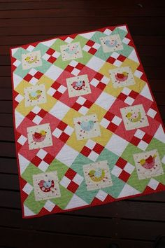 Love this quilt! Birdie fussy cut blocks and nice use of simple blocks of color