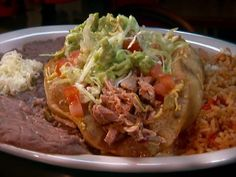 Puffy Tacos With Guy Fieri : Guy Fieri makes puffy tacos at a cafe named for its famous dish: Taco Taco.
