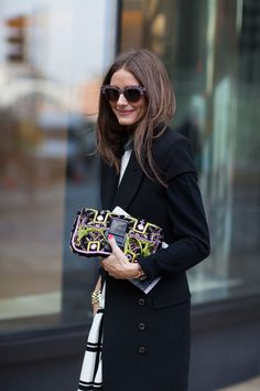 Olivia Palermo wears a classic coat with an embellished bag & sunnies for a perfect mix. #LondonStreetStyle.