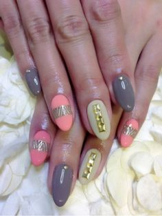 OMG I love these nails I a specially love the gold studs on the white new and the chevron on the pink nails <3