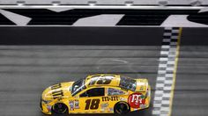 DAYTONA 500 QUALIFYING:   Kyle Busch crosses the finish line to win the second of the twin qualifying races for the Daytona 500, at Daytona International Speedway, in Daytona Beach, Fla., Thursday night, February 18, 2016. (Joe Burbank/Orlando Sentinel)