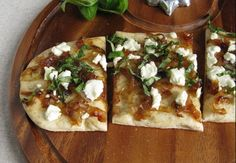Caramelized onions, goat cheese and basil flat bread - I think a drizzle of good aged Balsamic would be a delicious addition!