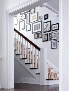 Dark wood floors with gray walls. Also love the photo arrangement.