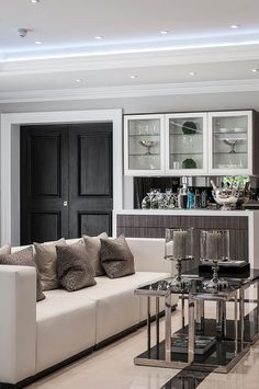 Contemporary seating area in the kitchen of luxurious surrey mansion designed by www.aji.co.uk
