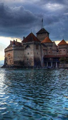 Chillon Castle, Switzerland - The Château de Chillon is an island castle located on the shore of Lake Geneva in the commune of Veytaux, at the eastern end of the lake, 3 km from Montreux, Switzerland.