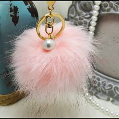 Pink pom pom keychain faux fox fur with pearl NWOT! Brand new!! Faux fox fur but really soft and great quality. Gold hardware.  Size: (approx) Ball Diameter = 8cm  Its a keychain, you can also use it to put as purse charm or just to hold any key.  Great gift for your family, friends or your self.  ** color might be slightly different cause of the lightning  Great for your Louis Vuitton, Prada, Fendi, Chanel, Michael Kors, Gucci, Coach Tory Burch, Kate spade, Marc jacobs and others…