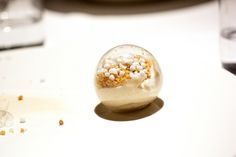"""""""A sugar pinata filled with orange supreme, guava cream, meringue, crushed peanut cookies"""" from a restaurant, Pujol in Mexico City."""