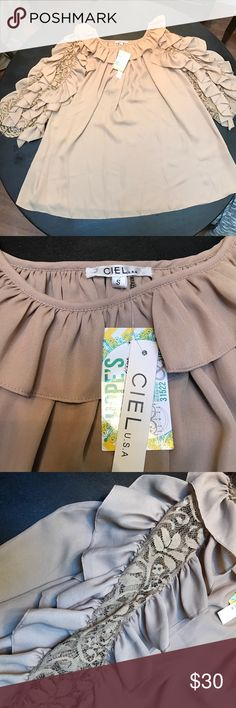 NWT Ciel Home Sweet Home Dress Size Small in Tan This dress has amazing ruffled and lace sleeves. It is brand new with tags in a size small. The dress is made of Polyester and might need a slip as it is a little sheer. Imagine all the possibilities! Ciel Dresses