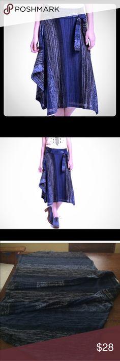 Indigo striations skirt by sparrow Super cute knit blue indigo skirt with asymmetrical sides and belt. Size medium Anthropologie Skirts