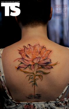 Lotus tattoo by Wang