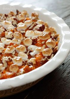 Sweet potatoes, golden raisins, crushed pineapple and spices are topped with pecans and mini marshmallows, then baked until golden.  I've gotten several requests for sweet potato casserole in the past, to be honest with you, I've never been a fan. But I thought that was selfish of me, so I decided to make one here for all of you who do like it. I think the colors are beautiful and this would be a wonderful addition to your Thanksgiving table.  I tested this out on my sweet potato casserole…