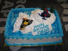 Snowmobile Cake:   Our family loves to snowmobile. I made this fun snowmobile cake for our son's birthday party. It was a snowmobile party! Him and his friends loved it!