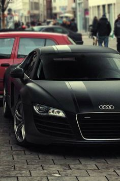 Audi R8 matte black, with big satin black stripes. That is surely one difficult to maintain finish.