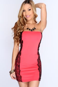 When the night falls, your date will fall for the girl in this gorgeous dress! This evening will enchant you with a romantic dinner and starlit dancing in this beautiful dress. Featuring strapless style, lightly padded bra cups, eyelash lace trim, short length, two toned, tight fitted, and finished with a detached necklace. 95% polyester 5% spandex. Made in USA