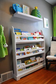 Magazine rack for baby books! So cute so the little ones can see what they would like and reach books without pulling them all out at once