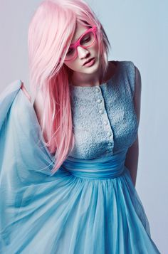 Pink hair blue dress.