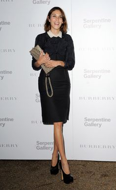 Alexa Chung in a Carven navy dress with contrasting white collar and bow accent.
