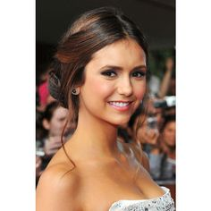 Check Out the Little Move That Made Nina Dobrev's Bun Look All... ❤ liked on Polyvore featuring nina dobrev, hair, vampire diaries, models and nina