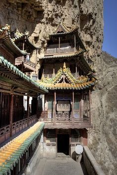 The one room deep Hanging Temple near Datong by Anne Roberts on Flickr - China. Built more than 1,500 years ago, this temple is notable not only for its location on a sheer precipice but also because it includes Buddhist, Taoist, and Confucian elements. The structure is kept in place with wooden crossbeams fitted into holes chiseled into the cliffs