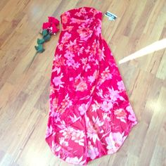 Stapless sundress flower print never worn. Never worn flower print longer n back would be great in heels or flats  size medium elastic up top to fit a small person it's a medium .i could only check off two colors it also has other in print. Byer too. Dresses Strapless