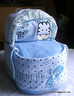 Baby Boy Bassinet    Contents: 20 disposable diapers, 3 burp cloths, 2 bibs